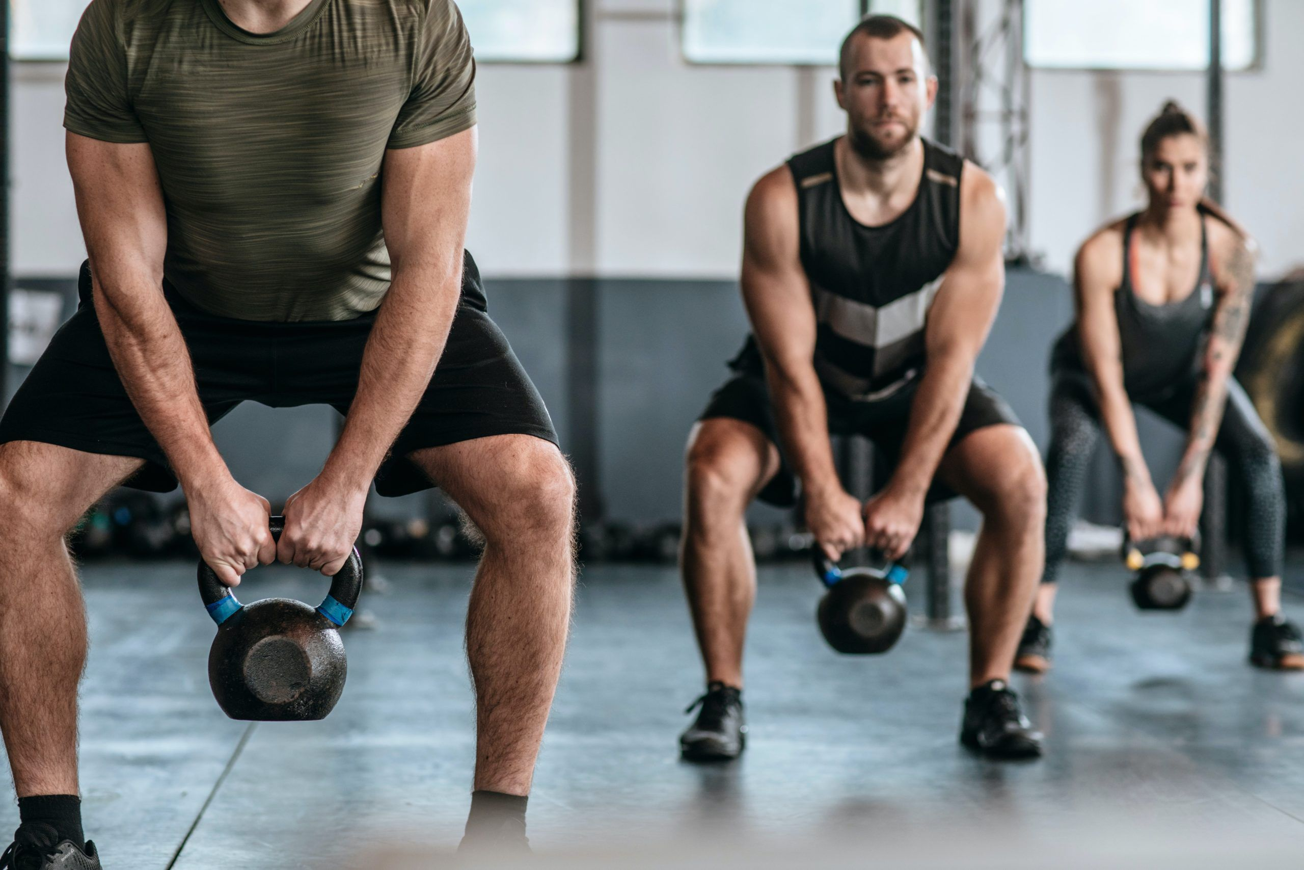 group class kettlebell swings